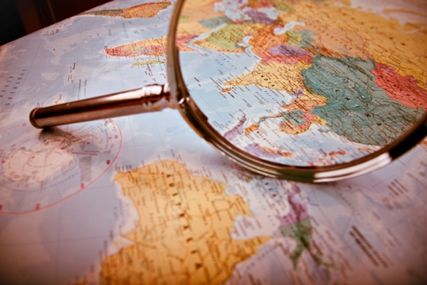 Magnifying glass globe iStock_000008356261_Large 600x400